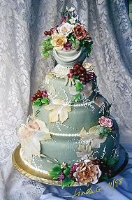 pretty green and white cake with grapes and flowers