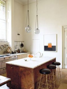 The modern kitchen of of an elegant London home on Thou Swell