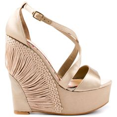 You haven't seen a wedge quite like this adorable CeCe Lamour style.  The Kiera is wrapped in an elegant champagne satin with threaded details fanning over the 5 1/2 inch wedge.  Overlapping straps create the vamp and shows off a 2 inch platform.