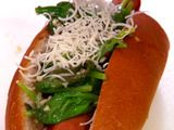 Maui's Hot Dog Soprano: In a saute pan on med, heat olive oil and crushed red pepper flakes. When oil is hot, add garlic and cook until it turns golden brown, but be careful not to burn it. Add the baby spinach and toss once. Deglaze the pan with white wine and turn off the heat. The spinach should be slightly wilted. Add this mixture on top of your Maui dogs and add extra-sharp provolone on top of the spinach, to desired taste. X