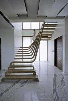 minimal stairs - plain wood, integrated railings, see through... perfect design! C.