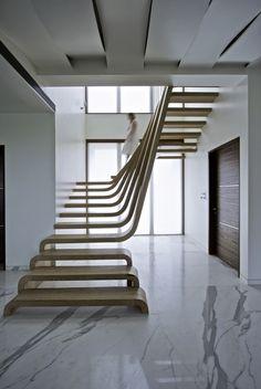 minimal stairs - plain wood, integrated railings, see through... perfect design! C.