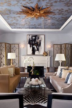 Two DIFFERENT Sofas---Eclectic living room by Elizabeth Gordon.  I love the idea of two sofas, and they don't match, the ceiling being wallpapered with the mirror in the center, and the artwork and sconces!