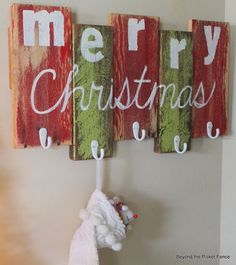 Pretty and cheap idea. Make a place to hang stockings with painted boards and attach hooks.