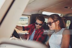Stock Photo : Couple in a car looking at the map for directions