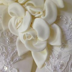 """Aren't these silk flowers against the beaded lace on this dress just gorgeous.  They add a great mix of dimension and texture of the dress.  We are passionate about creating designs you love to reflect your personality and individuality, designed in our studio and hand made as we are proud advocates of """"Made In England"""".  #lesleycutlerbridal #wedding #weddingdress #bride #bridetobe #bridetobe2020  #bridetobe2019 #"""