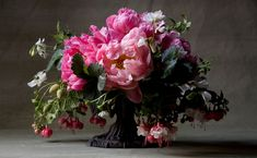 ! I'm buying a fuchsia plant this summer so I can arrange this! Fuchsia, peonies, strawberry leaves