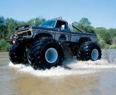 Here's a monster truck driving through a lake.