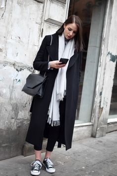 I love breaking up an all black look with a statement scarf. it doesn't have to be a print or anything, just huge and in a contrasting colour to the rest of your look!