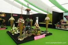 Janet Arm, Linda Brown, Valerie Clark, and Jean Warren from Aldershot Floral Design Club have designed and created this beautiful floral exhibit for the RHS Hampton Court Palace Flower Show. This magnificent exhibit was specially designed to publicise The NAFAS Festive Flower and Food Show, which will be held in Blackpool, from the 9th to the 11th of November 2017.