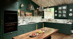 Trends in Kitchen Design - Formal Artwork, dark cabinetry.  Farmhouse sinks--will they ever be 'out.'  I doubt it.