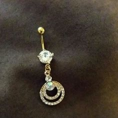 Double circle rhinestone belly ring Double circle rhinestone belly ring.  Gold trim. Buy 2 get one free. The lesser value will be free. Will make a new listing for multiples Jewelry