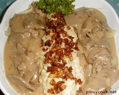 Ox tongue in mushroom sauce served with mashed potatoes topped with browned onion bits. It really sounds continental but, believe it or not, most Filipino cookbooks include a version of this dish. My father had his own version too. This is mine. Because of its price in the Philippines, ox tongue is served mostly in …