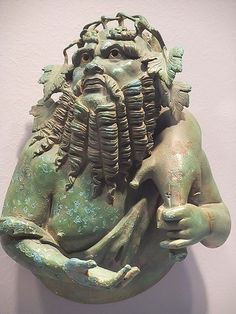 Bust of Silenus that once adorned a Roman dining couch 1st century BCE-1st century CE Bronze with traces of silver inlay