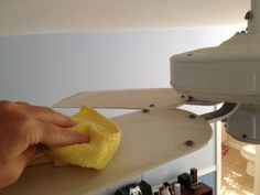 Wipe ceiling fan blades with a damp microfiber cloth.