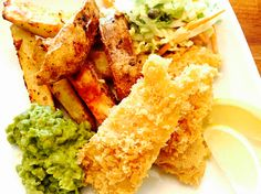 Our world wide dairy & gluten free weekly menu plan brings us the distinctly enjoyable comfort food of Northern Europe, in the form of fish and chips from jolly old England! Gluten Free Fish And Chips, Mushy Peas, Weekly Menu Planning, Coleslaw, Fries, Dairy, England, Europe, Ethnic Recipes