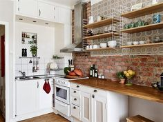 exposed bricks in the kitchen (via Stadshem) - via my ideal home