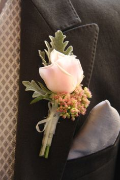 A Sweet Avalanche Rose Boutonniere - make sure all groomsmen have their boutonniere on