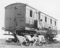 June 22 1936, A family holiday in a fitted LNER railway coach at Brightlingsea, Essex, England. The station master delivers the morning mail to Mrs Jennings. (Photo by Fred Morley/Fox Photos/Getty Images)