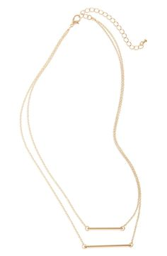 So pretty! Matching bar charms dangle from delicate chains on this simple two-layer necklace with a bright golden finish.