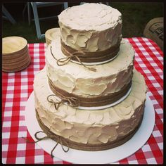 Country theme weddings are very popular this year and the burlap and twine add a rustic touch.  #wedding #cake