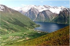 Sæbø is the church site with Bondalen, the valley which extends about 10 km westwards to Bondalseidet and Ørsta. In the background Elsandtindane,  Sæbø was formerly the center of Hjørundfjord municipality, but was in the 1960s  a part of Ørsta.