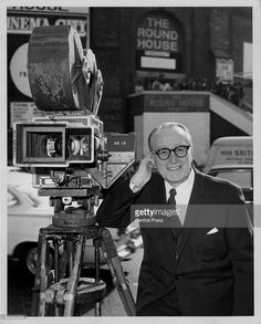 Actor Harold Lloyd posing with one of the first color cine-cameras, at the 'Cinema City' exhibition at the Roundhouse, London, September 22nd 1970.