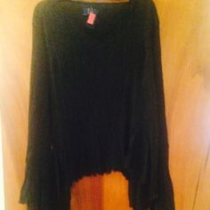 Cute vampy style blouse! 100% polyester. Long flaring sleeves loose fitting. Tops Blouses