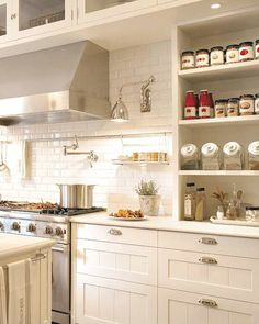***excellent storage and smart space planning--spices right next to stove, great task lighting over cooktop and workspace area.  love the metal bar across the backsplash for hanging utensils, towel, mini spice rack, etc (like current ikea pot rack)