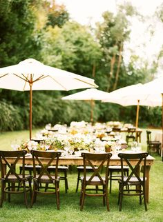 Chic outdoor wedding with tables and umbrellas