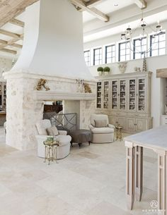 French Country Fireplace, White Fireplace, French Country House, Living Room With Fireplace, Limestone Fireplace, Fireplace Seating, Fireplace Design, Stone Kitchen Floor, Double Sided Fireplace