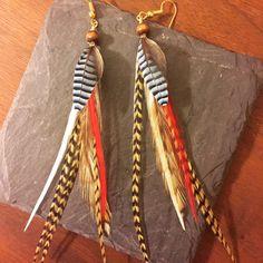 Handmade Feather Earrings from Wilderman's Etsy Shop #bluejayfeathers #featherearrings #feathers #boho #bohemian #hippie #mountainwear #handmade #jewelry #earrings #festivalwear #roosterfeathers #etsy #forsale #coloradostyle #custom  www.etsy/shop/wildermans