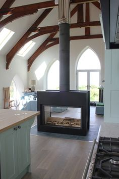 Firebelly FB3 Double Sided Wood Burning Stove - great idea