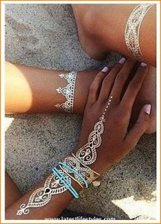 Beautiful White Henna Tattoos for Hands  http://www.latestlifestyles.com/white-henna-designs-temporary-tattoos-on-skin/beautiful-white-henna-tattoos-for-hands-6/