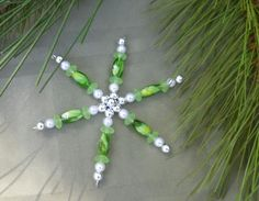 Handcrafted Green Snowflake This snowflake measures 3 1/2 and is a combination of faux pearls, silver and glass green beads..    Snowflakes can