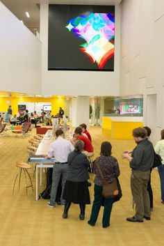 Visible from both learning commons areas on the third and fourth floors, the Commons Wall is at the center of the library's academic activity. Yellow Stairs, Nc State University, Three Floor, Common Area, Libraries, North Carolina, Activities, Learning
