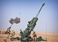 Marines 1st Battalion, 12th Marine Regiment, fire an M982 Excalibur round from an M777 howitzer