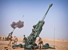 Marines 1st Battalion, 12th Marine Regiment, fire an M982 Excalibur round from an M777 howitzer