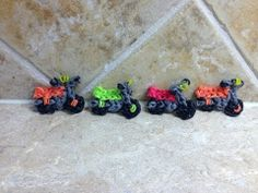 Rainbow Loom MOTORCYCLE charm. Designed and loomed by Cheryl Spinelli at Looming WithCheryl. Click photo for YouTube tutorial. 04/22/14.