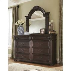 Shaped and beveled Bedroom Mirror from the Caprivi Collection. #MasterBedroom #OldWorld