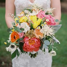 A lush bouquet with tulips, roses, and anemones is perfect for a springtime wedding.