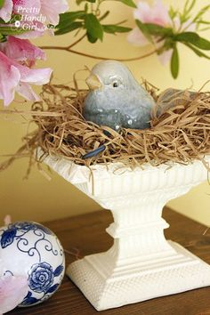 bird in nest on white pedestal! I have a pair of these birds! Found these birds at a garage sale ♥ them!