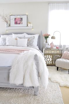 The best way to achieve a cozy feel is to add layers! Layers of different textures will create so much interest and depth to any design. Here I've layered 2 duvet covered comforters, linen and cotton. Then I added a quilted satin blanket I found at HomeGoods. The faux fur throw is another layer that is practical and a little whimsical. Sponsored by HomeGoods