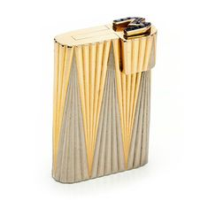 FD Gallery | A Bi-colored Gold and Sapphire Lighter, by Cartier circa 1930 (=)
