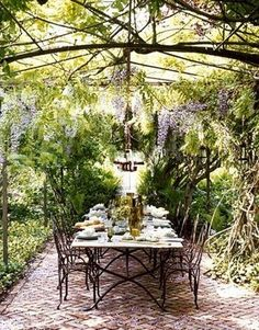 I dream of entertaining family around a huge, rustic, outdoor table like this one.