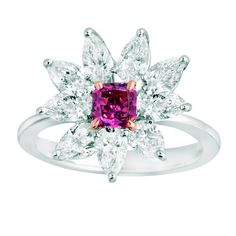 The center stone in the AMGAD Red Diamond Flower Ring is a radiant shaped Fancy Purplish Red Diamond from the Argyle Mine in Australia, the world's top source for these rare colored stones. It's with of colorless pear shape diamonds. Jewelry Show, Jewelry Gifts, Jewelry Design, Jewellery, Jewelry Art, Titanic Jewelry, Pink Gemstones, Pear Shaped Diamond, Diamond Flower