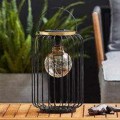 LED Solar Black Outdoor Firefly Bulb Metal Lantern | Dunelm Garden Lanterns, Metal Lanterns, Patio Plans, Cosy Corner, Solar Panels, Contemporary, Modern, Outdoor Lighting, Light Up