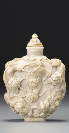 AN IVORY 'BUDDHIST LIONS' SNUFF BOTTLE<br>IMPERIAL MASTER, JAPAN, LATE 19TH / EARLY 20TH CENTURY | lot | Sotheby's