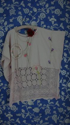Absolutely stunning 1920s style pretty romantic pale pink embroidered dress tunic. This beauty has been fashioned from two vintage tablecloths. The top of the dress is a lovely pale pink linen with outstanding embroidery down the front and back. This is a dropped shoulder style bodice