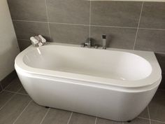 Double ended Bath grey tiles